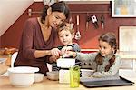 Mother and children cooking in kitchen Stock Photo - Premium Royalty-Free, Artist: Cultura RM, Code: 649-06533516