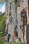 Rock climbers scaling steep face Stock Photo - Premium Royalty-Free, Artist: ableimages, Code: 649-06533541