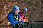 Rock climbers securing carabiners Stock Photo - Premium Royalty-Free, Artist: CulturaRM, Code: 649-06533565