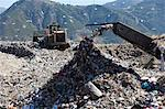 Machinery dumping waste in landfill Stock Photo - Premium Royalty-Free, Artist: CulturaRM, Code: 649-06533597