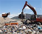 Machinery grabbing waste in landfill Stock Photo - Premium Royalty-Free, Artist: CulturaRM, Code: 649-06533601