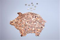 represented - Euro coins falling into a piggy bank made from arranged European coins Stock Photo - Premium Royalty-Freenull, Code: 653-06533847
