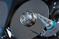 Detail of inside of computer hard drive Stock Photo - Premium Royalty-Freenull, Code: 653-06533988