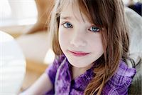 preteen girls faces photo - A young girl looking serenely into the camera Stock Photo - Premium Royalty-Freenull, Code: 653-06534065