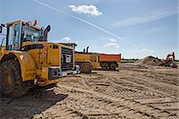 Construction vehicles on work site Stock Photo - Premium Royalty-Freenull, Code: 653-06534498
