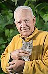 A senior man holding a kitten Stock Photo - Premium Royalty-Free, Artist: GreatStock, Code: 653-06534666