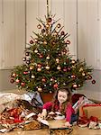 Little girl unwrapping Christmas Presents. Stock Photo - Premium Royalty-Free, Artist: iRepublic, Code: 6106-06535797