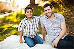 Father and son on picnic blanket Stock Photo - Premium Royalty-Free, Artist: CulturaRM, Code: 614-06536727