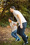 Father and son running together Stock Photo - Premium Royalty-Free, Artist: Cultura RM, Code: 614-06536729