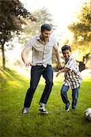 Father and son playing soccer together Stock Photo - Premium Royalty-Freenull, Code: 614-06536730