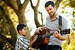 Father and son playing guitar together Stock Photo - Premium Royalty-Free, Artist: Susan Findlay, Code: 614-06536732