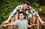 Father and son playing on wooden bridge Stock Photo - Premium Royalty-Free, Artist: photo division, Code: 614-06536734