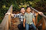 Father and son playing on wooden bridge Stock Photo - Premium Royalty-Free, Artist: CulturaRM, Code: 614-06536740