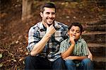 Father and son sitting on stone steps Stock Photo - Premium Royalty-Free, Artist: Minden Pictures, Code: 614-06536743