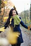 Woman playing in autumn leaves Stock Photo - Premium Royalty-Freenull, Code: 614-06536865