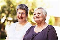 Older women smiling together outdoors Stock Photo - Premium Royalty-Freenull, Code: 614-06536951
