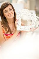 Smiling woman shopping in store Stock Photo - Premium Royalty-Freenull, Code: 614-06537056