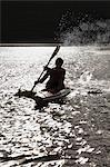 Man rowing kayak in lake Stock Photo - Premium Royalty-Free, Artist: Blend Images, Code: 614-06537083