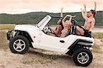 Friends driving jeep on sand dune Stock Photo - Premium Royalty-Free, Artist: CulturaRM, Code: 614-06537086