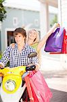 Couple carrying shopping bags on scooter Stock Photo - Premium Royalty-Free, Artist: Robert Harding Images, Code: 614-06537155