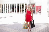 people on mall - Woman carrying shopping bags outdoors Stock Photo - Premium Royalty-Freenull, Code: 614-06537160