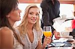 Woman having orange juice in cafe Stock Photo - Premium Royalty-Free, Artist: ableimages, Code: 614-06537168