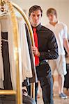 Porter pushing luggage cart in hotel Stock Photo - Premium Royalty-Free, Artist: Water Rights, Code: 614-06537185