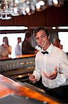 Waiter taking order at restaurant bar Stock Photo - Premium Royalty-Free, Artist: Blend Images, Code: 614-06537206