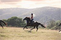 Woman riding horse in rural landscape Stock Photo - Premium Royalty-Freenull, Code: 614-06537220