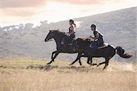 Couple riding horses in rural landscape Stock Photo - Premium Royalty-Freenull, Code: 614-06537226