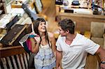 Couple shopping together in thrift store Stock Photo - Premium Royalty-Free, Artist: Blend Images, Code: 614-06537270
