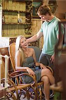 Couple shopping together in thrift store Stock Photo - Premium Royalty-Freenull, Code: 614-06537271