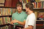 Men shopping together in thrift store Stock Photo - Premium Royalty-Free, Artist: Blend Images, Code: 614-06537276