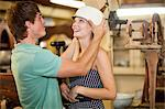 Couple shopping together in thrift store Stock Photo - Premium Royalty-Freenull, Code: 614-06537277