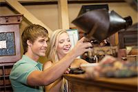 Couple shopping together in thrift store Stock Photo - Premium Royalty-Freenull, Code: 614-06537278