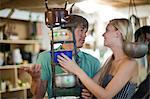 Couple shopping together in thrift store Stock Photo - Premium Royalty-Free, Artist: Huber-Starke, Code: 614-06537281