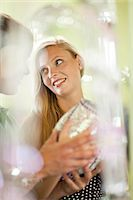 Couple shopping together in store Stock Photo - Premium Royalty-Freenull, Code: 614-06537289