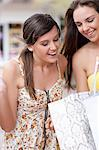 Woman looking in shopping bag Stock Photo - Premium Royalty-Free, Artist: Aflo Relax, Code: 614-06537291