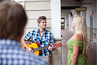 Man playing guitar for girlfriend Stock Photo - Premium Royalty-Freenull, Code: 614-06537304