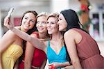 Women taking picture together outdoors Stock Photo - Premium Royalty-Free, Artist: Blend Images, Code: 614-06537307