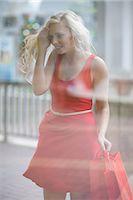 shopping mall - Woman window shopping on street Stock Photo - Premium Royalty-Freenull, Code: 614-06537344