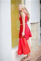 Woman window shopping on street Stock Photo - Premium Royalty-Freenull, Code: 614-06537345
