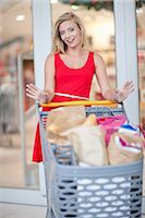 Women pushing shopping cart Stock Photo - Premium Royalty-Freenull, Code: 614-06537362