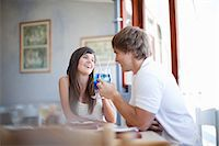 Couple toasting with cocktails Stock Photo - Premium Royalty-Freenull, Code: 614-06537377