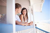 Couple drinking wine together on deck Stock Photo - Premium Royalty-Freenull, Code: 614-06537380