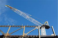 Low angle view of crane at construction site Stock Photo - Premium Royalty-Freenull, Code: 614-06537434