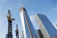 Low angle view of crane and skyscrapers Stock Photo - Premium Royalty-Freenull, Code: 614-06537441