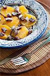 Plate of fruit and nuts on placemat Stock Photo - Premium Royalty-Free, Artist: Angus Fergusson, Code: 614-06537500