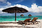 Chairs and umbrella on tropical beach Stock Photo - Premium Royalty-Free, Artist: photo division, Code: 614-06537511