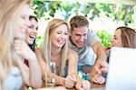 Friends using laptop together Stock Photo - Premium Royalty-Free, Artist: Blend Images, Code: 614-06537612